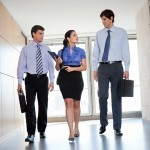 three employees walking together