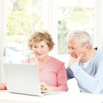 Older couple staring at computer screen