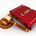 Law book and gavel, real estate attorney