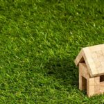 Small wood house on grass