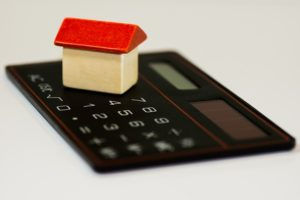 house model with calculator, real estate lawyer