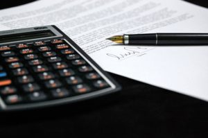 paper and calculator, real estate lawyer
