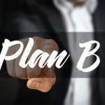 Businessman pointing to a plan B