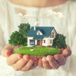 Hands holding a home property model